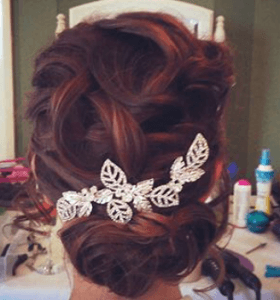 plaited sleek updo with hair slide
